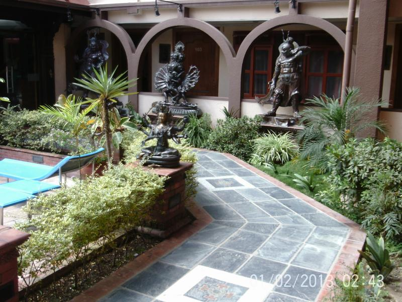 The hotel courtyard with many Hindu idols